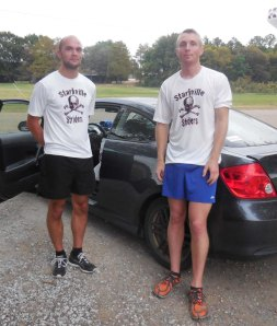 Max and Brent sporting the Starkville Striders skull and cross bones shirts
